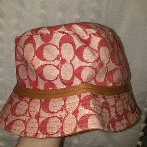 Pink coach bucket hat with leather detail.